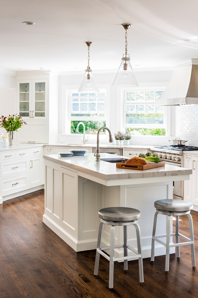 Eat-in kitchen - mid-sized transitional l-shaped dark wood floor eat-in kitchen idea in New York with an undermount sink, shaker cabinets, white cabinets, quartzite countertops, white backsplash, ceramic backsplash, stainless steel appliances and an island
