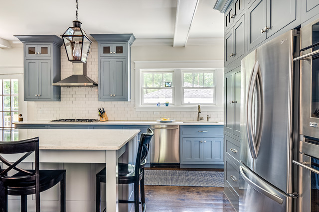 white and blue kitchen with stainless steel appliances