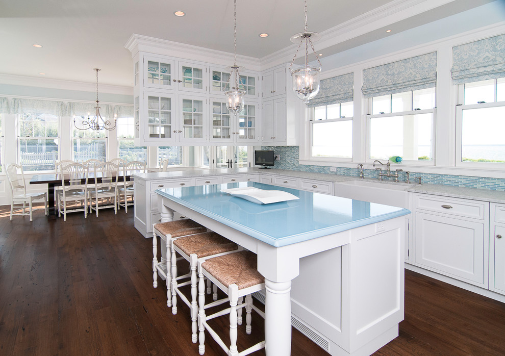 Inspiration for a timeless kitchen remodel in New York with recessed-panel cabinets, a farmhouse sink and blue countertops
