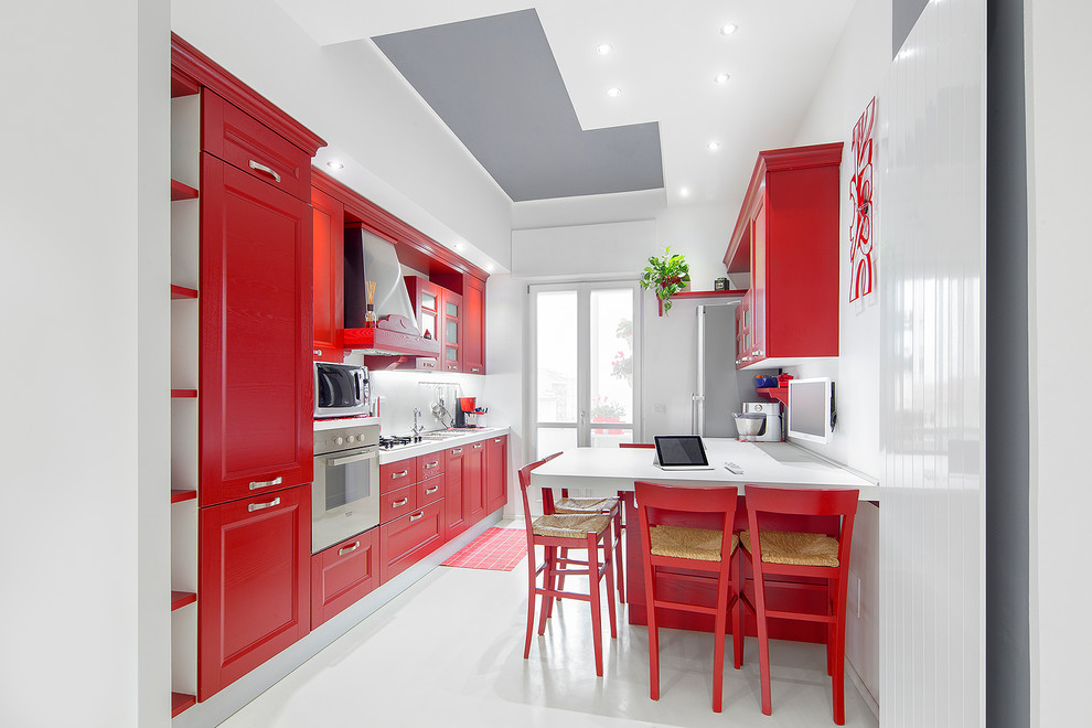 Eat-in kitchen - mid-sized eclectic single-wall porcelain tile eat-in kitchen idea in Turin with recessed-panel cabinets, red cabinets, white backsplash and stainless steel appliances