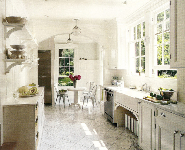 White cabinets, carrera marble counters, stainless appliances
