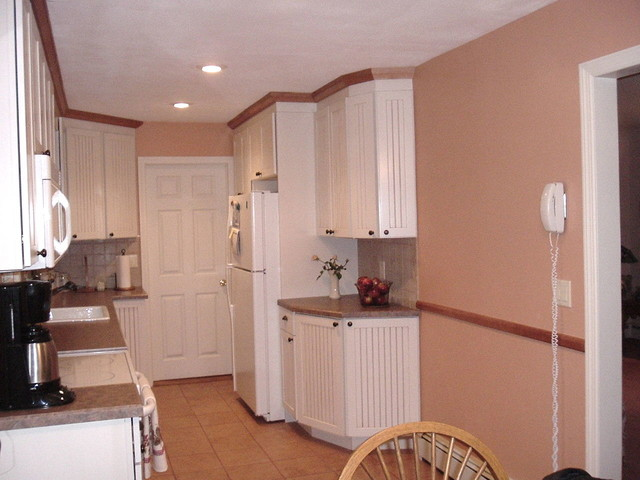 White Cabinets With A Touch Of Nutmeg Moldings
