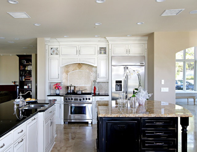 White cabinets with dark island in coto de caza - White kitchen with dark island ...