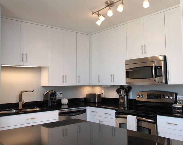 White Contemporary Kitchen With Brushed Nickel Hardware And Black
