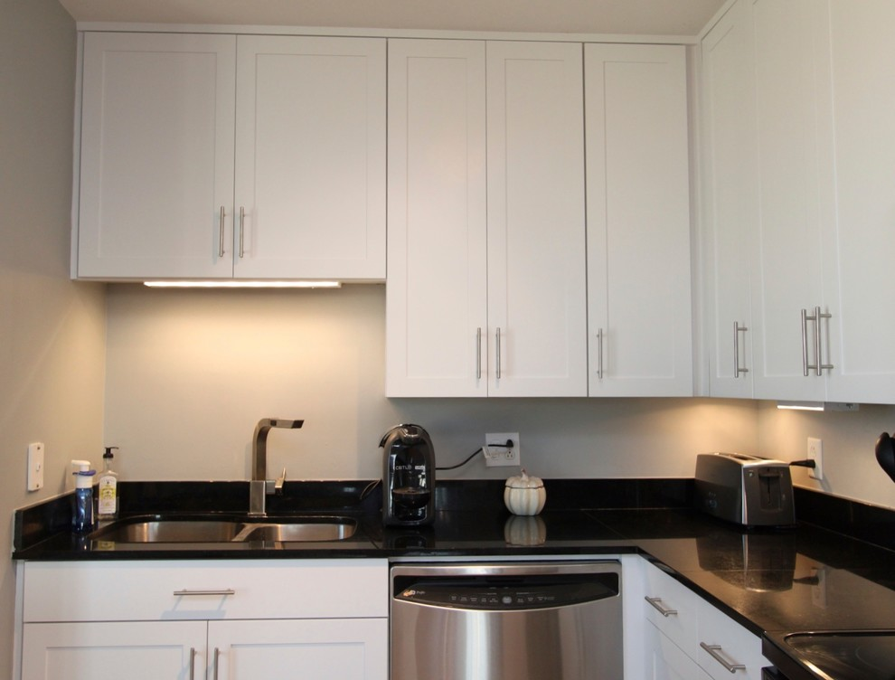 White Kitchen Cabinets With Brushed Nickel Hardware White Contemporary Kitchen with Brushed Nickel Hardware and Black