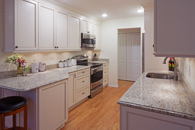 white kitchen cabinets in galley kitchen