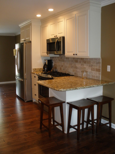 White galley kitchen traditional kitchen other metro for Galley kitchen designs with breakfast bar