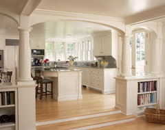 White kitchen and breakfast room with fireplace and arches traditional kitchen