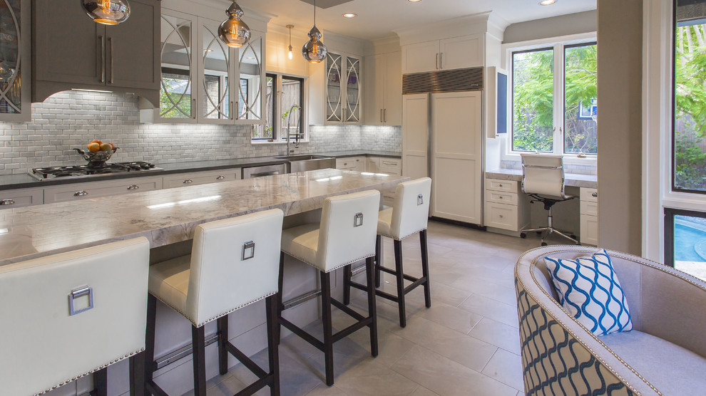 Example of a large eclectic single-wall ceramic floor open concept kitchen design in Houston with a farmhouse sink, glass-front cabinets, white cabinets, quartzite countertops, white backsplash, mosaic tile backsplash and a peninsula
