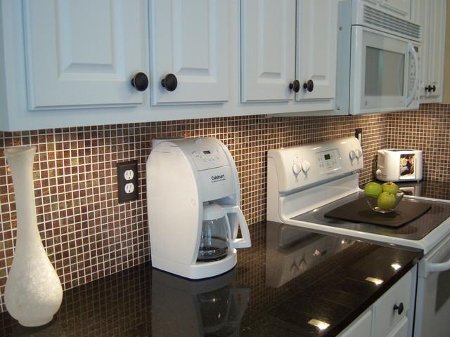 White kitchen, black granite with copper backsplash