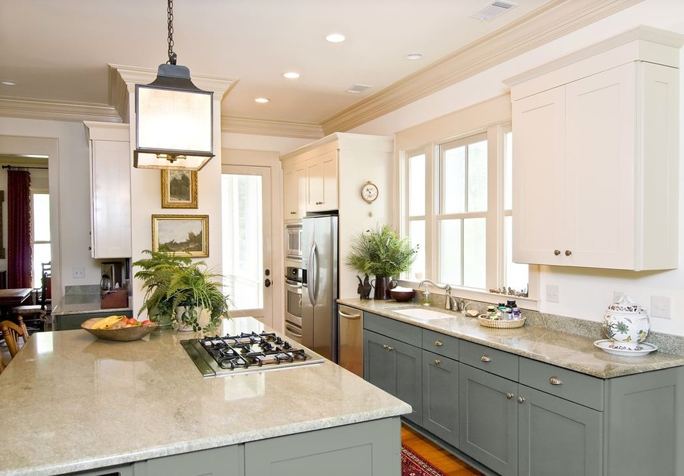 Elegant galley kitchen photo in Minneapolis with shaker cabinets, blue cabinets, stainless steel appliances, an undermount sink and white countertops