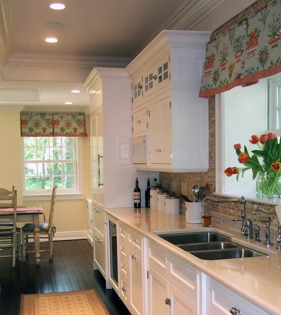 White Kitchen Dark Floors Colorful Window Treatment
