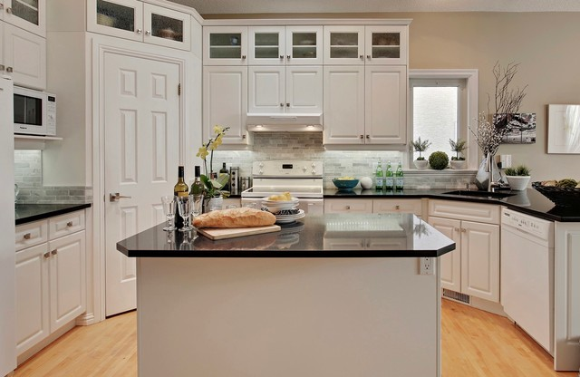 Kitchen - small traditional kitchen idea in Calgary