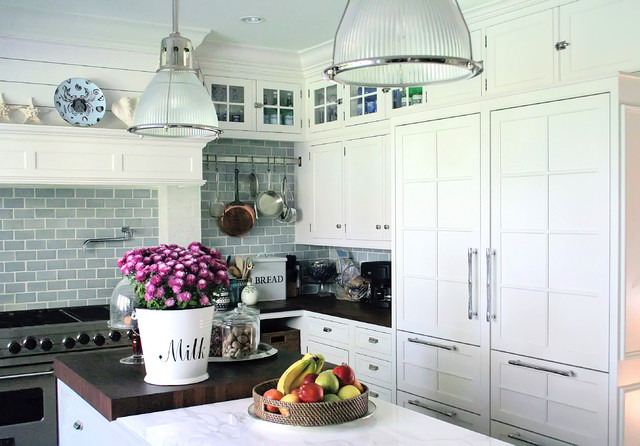 Elegant kitchen photo in New York with shaker cabinets, white cabinets,  blue backsplash,