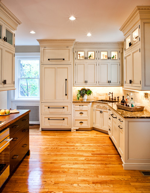 White Kitchen Renovation With Detailed Moldings And Trims