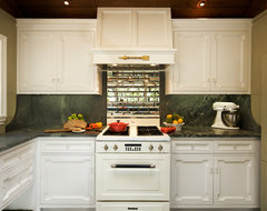 white kitchen, rubber floor, mirror backsplash, brazilian soapstone, panel fridg rustic-kitchen