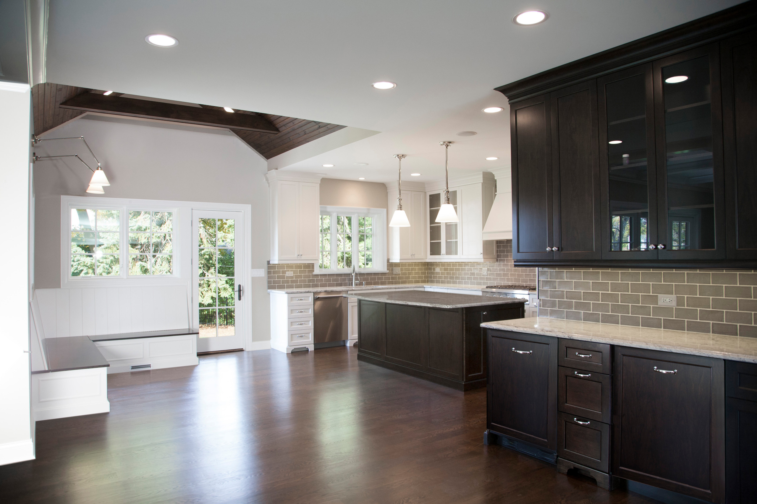 White Kitchen stained Perimeter Tongue and Groove ceiling and Banquette
