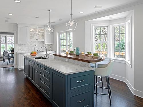 Multi-level kitchen island with gray countertops