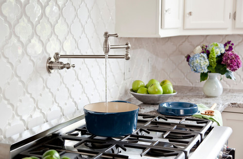 White Kitchen with Bianco Antico Granite, Beveled Arabesque tile contemporary kitchen