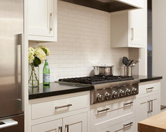 White kitchen with cooktop and hood traditional kitchen