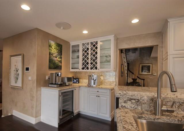 White kitchen with dark accent cabinets traditional kitchen
