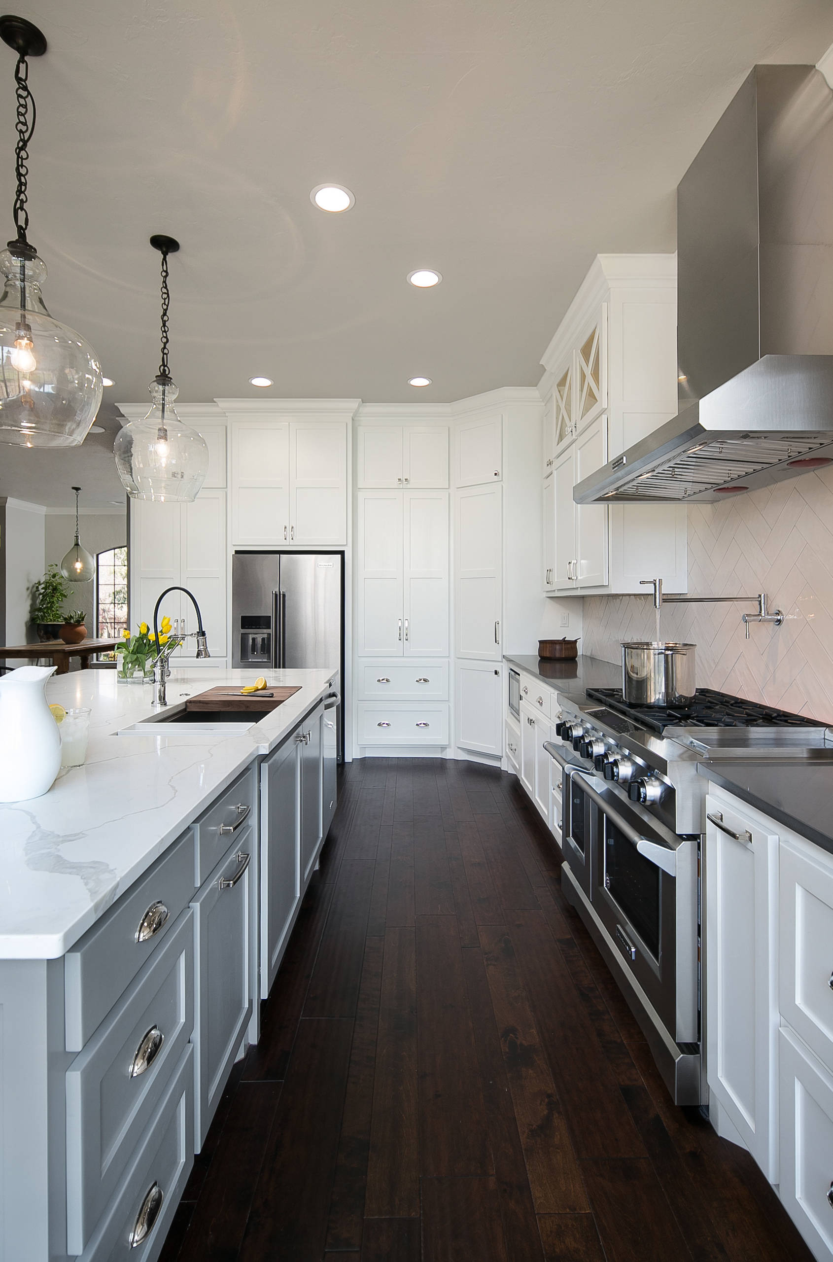 White Kitchen with Gray Island and Dark Counters