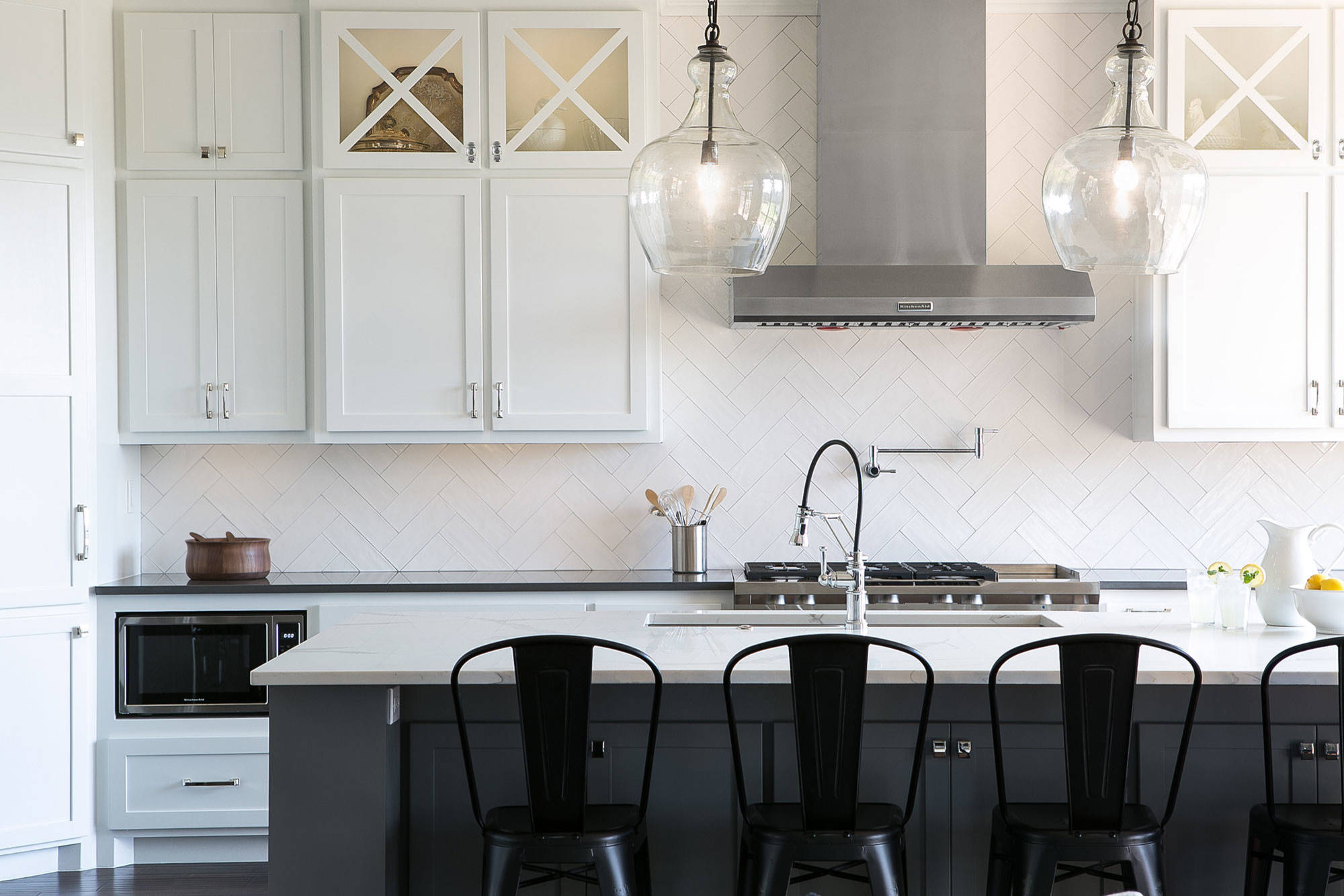 White Kitchen with Gray Island and Lights