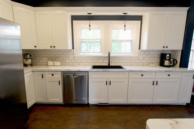 white kitchen with marble look laminate countertop akron
