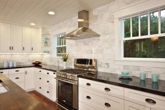 White And Black Traditional Kitchen white kitchen with wood island, carrara backsplash, black granite