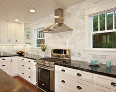 White Kitchen with wood island, carrara backsplash, black granite traditional kitchen