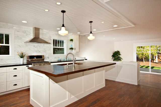 White Kitchen With Wood Island Carrara Backsplash Black Granite Traditional