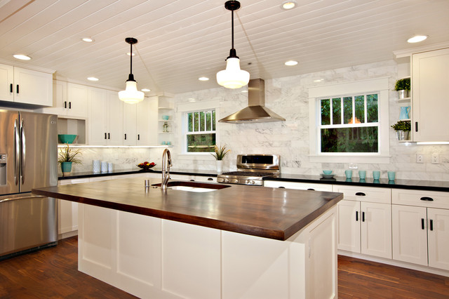 White Kitchen with wood island, carrara backsplash, black granite ...