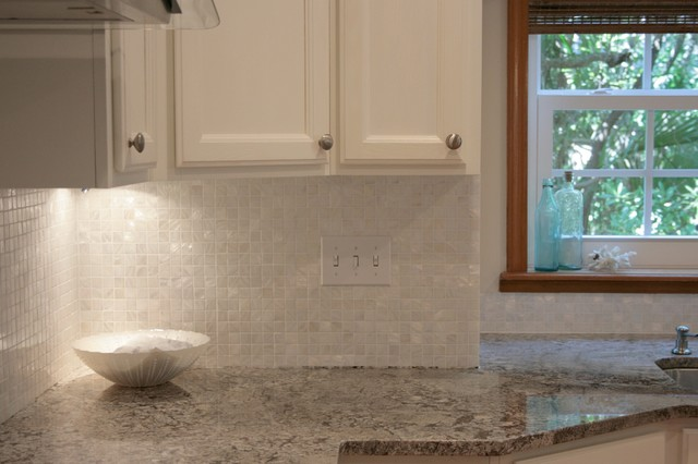 white mother of pearl 1 x 1 backsplash traditional kitchen