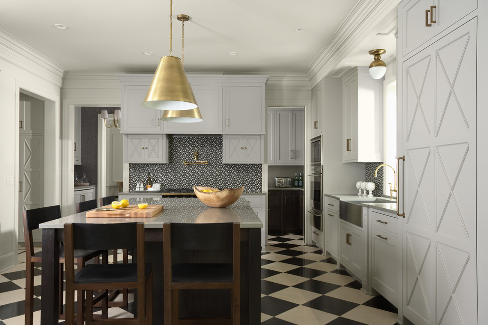 Inspiration for a transitional l-shaped multicolored floor enclosed kitchen remodel in Minneapolis with a farmhouse sink, white cabinets and black backsplash