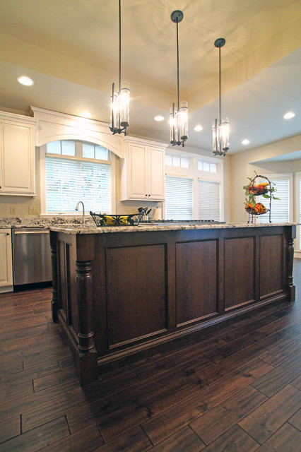 White Painted Cabinets with Mocha Stained Island traditional kitchen