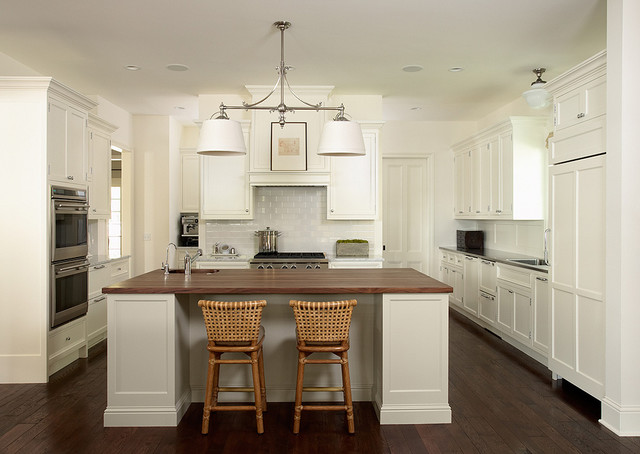 White Painted Kitchen With Wood And Stainless Sell Countertops