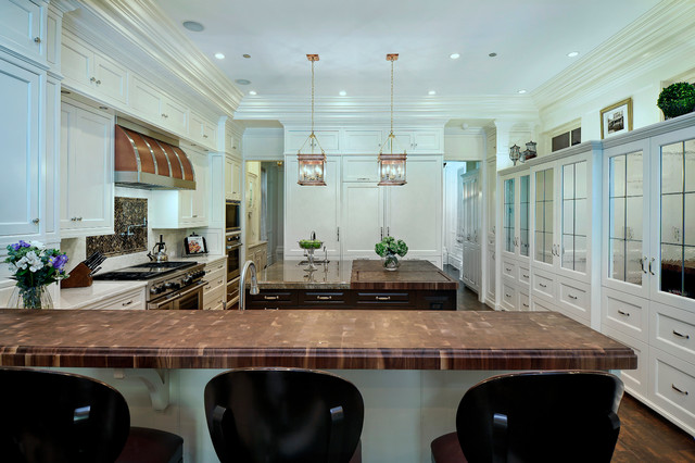 Inspiration for a huge timeless u-shaped dark wood floor eat-in kitchen remodel in Chicago with an undermount sink, stainless steel appliances, an island, shaker cabinets, white cabinets, marble countertops, white backsplash and stone slab backsplash