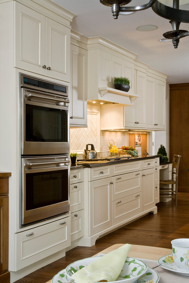 White Recessed Panel Brookhaven Cabinets with Subway Tile ...