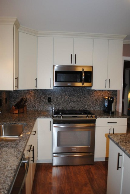 "White ""Rohe"" Cabinets, Oil Rubbed Bronze Cabinet Bar Pulls & Fixtures - Kitchen - other metro ..."