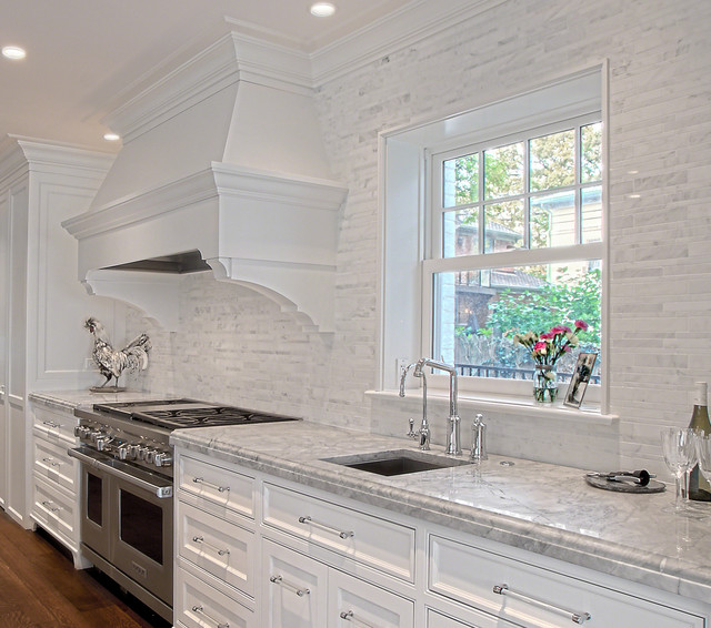 Stone backsplash white cabinets
