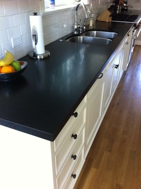 White subway tile with Brushed Absolute Black Granite eclectic-kitchen