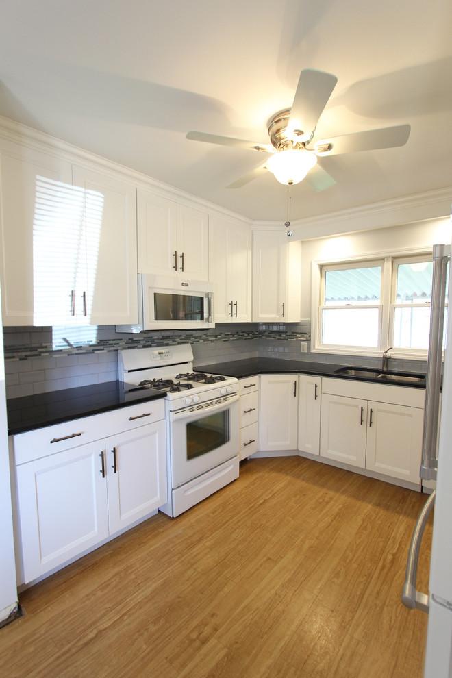 White Thermofoil Cabinets with Black Pearl Granite ...