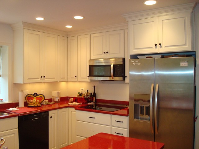 White W Red Countertops And Stained Accent Wall Modern