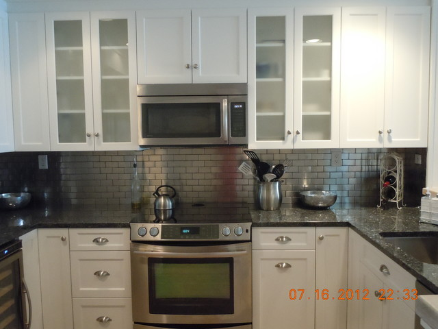 White With Metal Backsplash Traditional Kitchen