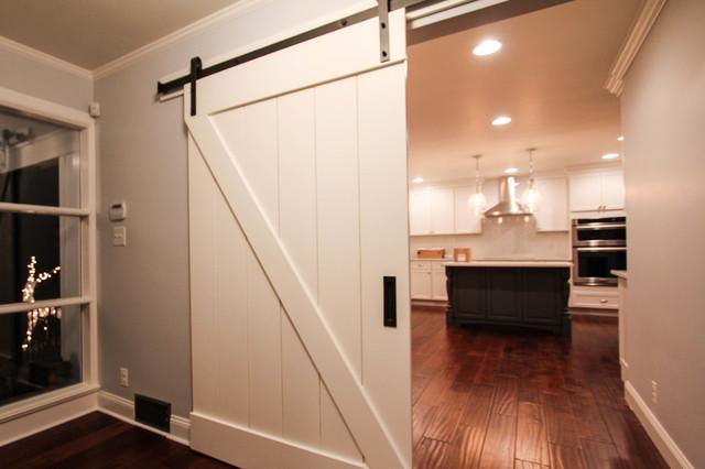 White wooden sliding barn door entering kitchen ...