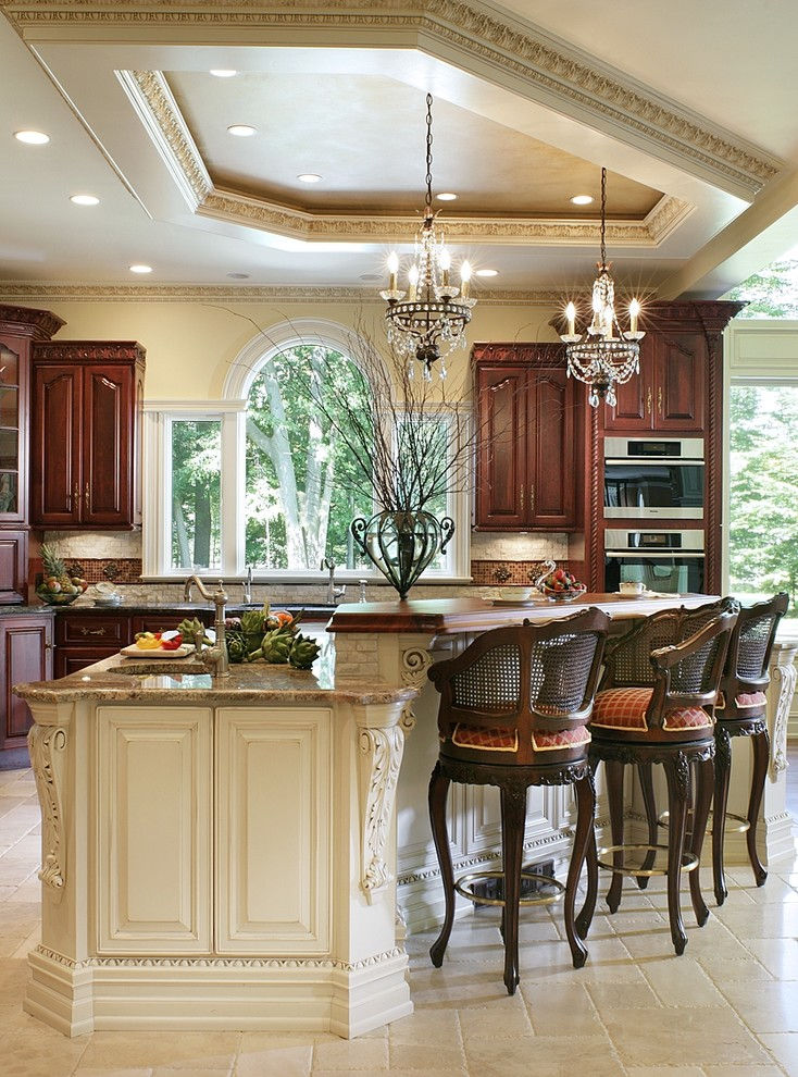Huge elegant open concept kitchen photo in New York with granite countertops, an undermount sink, raised-panel cabinets, light wood cabinets, beige backsplash, stainless steel appliances, an island and brown countertops