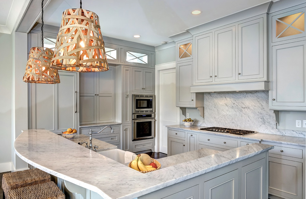 Example of a mid-sized classic l-shaped dark wood floor and brown floor kitchen design in Charleston with a farmhouse sink, gray cabinets, white backsplash, paneled appliances, beaded inset cabinets, stone slab backsplash, an island and quartzite countertops