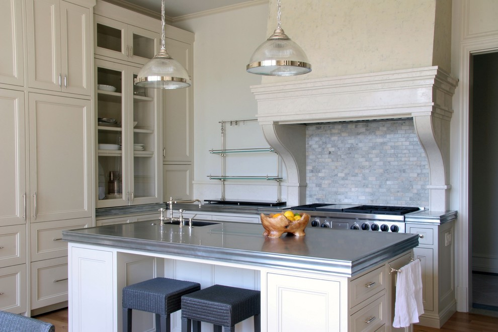 Transitional kitchen photo in Los Angeles with glass-front cabinets, beige cabinets, zinc countertops, multicolored backsplash, stone tile backsplash and paneled appliances