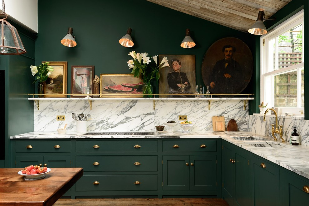 Inspiration for a mid-sized timeless l-shaped medium tone wood floor kitchen remodel in London with shaker cabinets, green cabinets, multicolored backsplash and a double-bowl sink