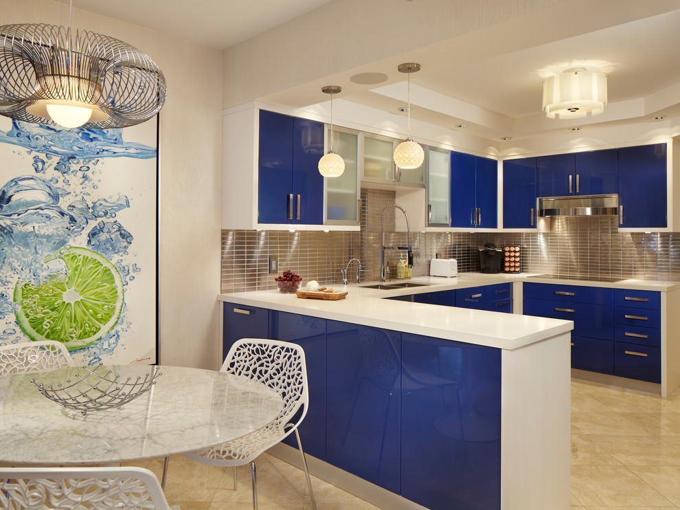 Mid-sized trendy u-shaped marble floor eat-in kitchen photo in Miami with flat-panel cabinets, blue cabinets, metallic backsplash, metal backsplash, a drop-in sink, quartzite countertops, stainless steel appliances and a peninsula